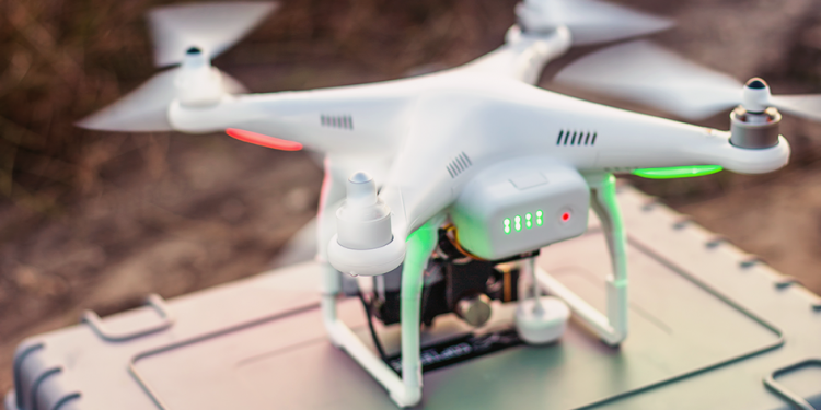 Drone ready to take flight over a field