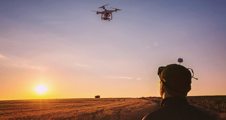 Drone flying over field taking infrared images